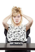 Blonde woman in business attire very angry and upset at desk — Stock Photo