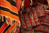 Moroccan cushions in a street shop in medina souk — Stock Photo