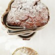 Chocolate chrismas muffin dusted sugar, heart shape trays — Stock Photo