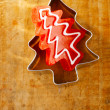 Christmas tree red candy in cookie cutter, wooden background — Stock Photo