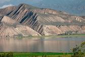 Toktogul highland mountain lake in Kyrgyzstan — Stock Photo