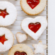 Linzer homemade cookies with heart shape raspberry jam window — Stock Photo
