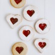 Linzer homemade cookies with heart shape raspberry jam window — Stock Photo #16273591