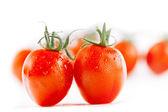 Cherry tomato on white backdrop with tomatoes on background, sh — Stock Photo