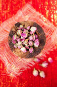 Rose tea buds in wooden bowl — Stock Photo
