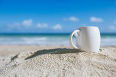 White espresso coffee cup with ocean , beach and seascape — Stock Photo