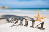 2014 letters with starfish, ocean , beach and seascape — Stock Photo