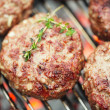 Food meat - beef burgers on bbq  barbecue grill with flame - ストック写真