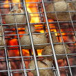 Stock Photo: Mushrooms in grill net bbq barbecue grill with fire