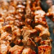 Shish kebab with the mix of spices on bbq — Stock Photo