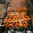 Shish kebab with the mix of spices on bbq - Stock Photo