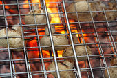 Mushrooms in grill net bbq barbecue grill with fire — Stock Photo