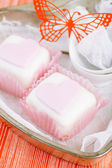 Heart shaped pink cupcakes in tin tray with spoons , red backgr — Stock Photo