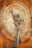 Two fork tied by string on old wood, selective focus, shallow do — Stock Photo