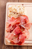 Platter of serrano jamon Cured Meat and ciabatta — Stock Photo