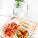 Platter of serrano jamon Cured Meat, Ciabatta, chorizo and olive — Stock Photo #26709251