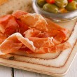 Stock Photo: Platter of serrano jamon Cured Meat and ciabatta