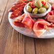 Stock Photo: Platter of serrano jamon Cured Meat, Ciabatta, chorizo and olive
