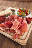 Platter of serrano jamon Cured Meat, Ciabatta, chorizo and olives — Stock Photo