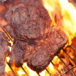 Stock Photo: Food meat - rib eye beef steak on party summer barbecue grill wi