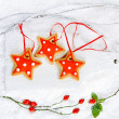 Gingerbread star cookies on white wood and snow background — Stock Photo