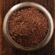 Stock Photo: Fine grated chocolate in bowl on wood , shallow dof