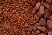 Cocoa beans and grated chocolate background — Stock Photo