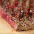 Beef steak on a wooden board and table — Foto de Stock