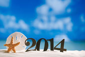 2014 letters with starfish, ocean — Stock Photo