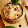 Sauerkraut - Sour cabbage -  on wooden bowl with bay leaves — Stock Photo