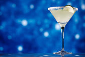 Margarita cocktail on star glitter dark blue background — Stock Photo
