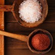Red and Pink Crystal Rock salt in rustic wooden spoons — Stock Photo