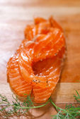 Smocked salmon slices and dill — Stock Photo