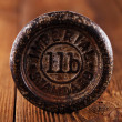 Vintage cast iron kitchen  weights om wood — Stock Photo