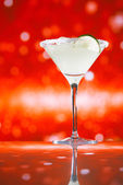 Margarita cocktail glitter red golden background — Stock Photo