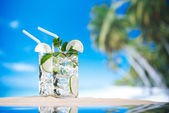 Mojito cocktail on beach sand and tropical seascape — Stock Photo