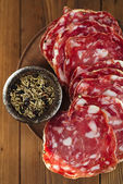 French salami with black peppercorn and fennel spices — 图库照片