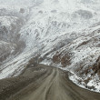 Steep turn high mountain road from Barskoon valley in Kyrgyzsta — Stock Photo