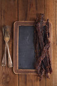 Jerky beef - homemade dried cured spiced meat — Stock Photo