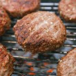 Stock Photo: Food meat - beef burgers on bbq barbecue grill with flame
