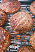 Food meat - beef burgers on bbq barbecue grill with flame — Stock Photo