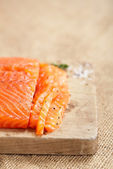 Smocked spiced salmon homemade on wooden board — Stock Photo