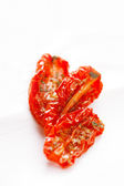 Sun-dried tomatoes with olive oil — Stock Photo