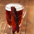 Jerky beef with beer — Stock Photo