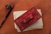 Vintage red leather ink blotter with retro post cards — Stock Photo
