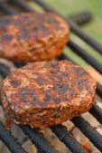 Food meat - burgers on bbq barbecue grill  — Stock Photo