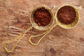 Grated chocolate and cocoa powder — Stock Photo