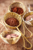 Hot chocolate flakes with chilli flavor in old rustic style silv — Stock Photo