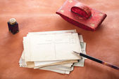 Vintage red leather ink blotter  with retro post cards on leathe — Stock Photo