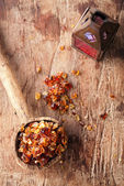 Gum arabic, also known as acacia gum - in  old wooden spoon — Stock fotografie